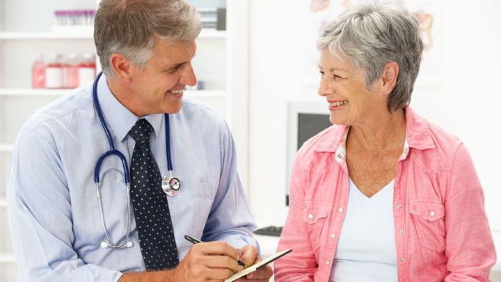 doctor talking to an older woman