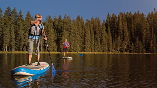 senior-couple-paddleboarding-in-Colorado