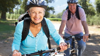 senior-couple-riding-bikes