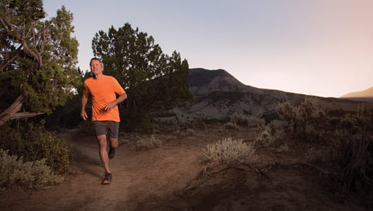 senior-man-running-against-Colorado-mountains