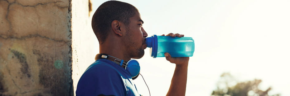 active-young-man-drinking-water