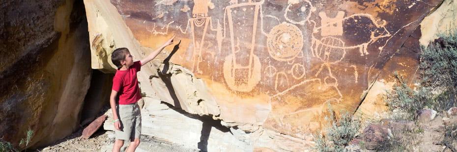 boy-points-to-petroglyphs-dinosauar-national-monument