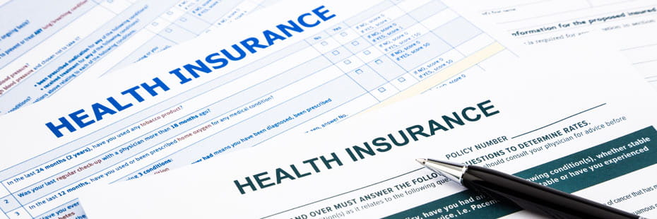 Health Insurance papers with Pen