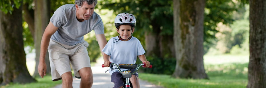 father-teaching-son-to-ride-a-bike