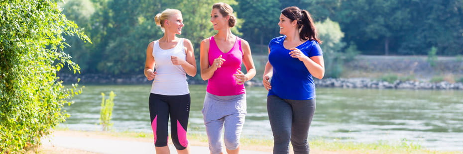 group-of-women-jogging-on-path
