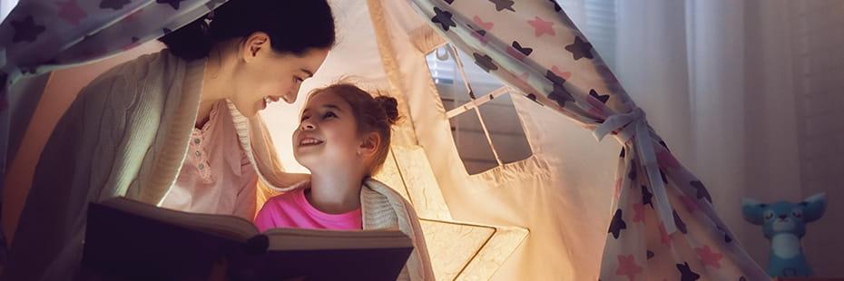 mother-reading-to-child_desktop