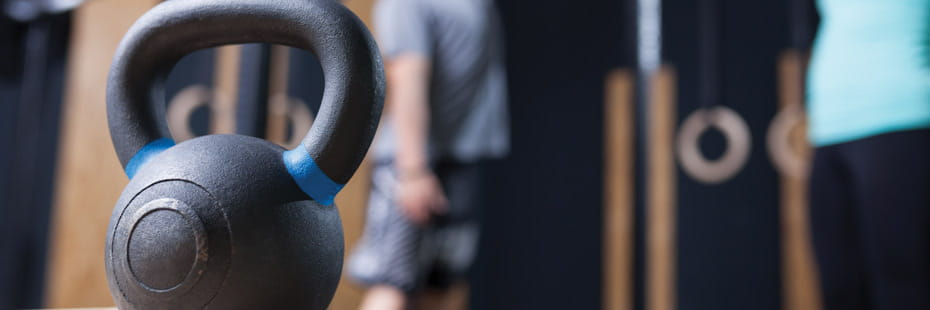 perspective-of-kettlebell-in-gym-with-people-working-out