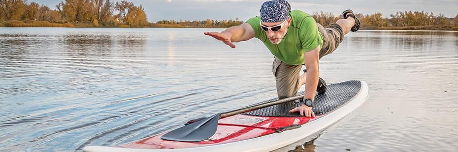 senior-man-stand-up-paddleboard-yoga-in-Colorado_Desktop