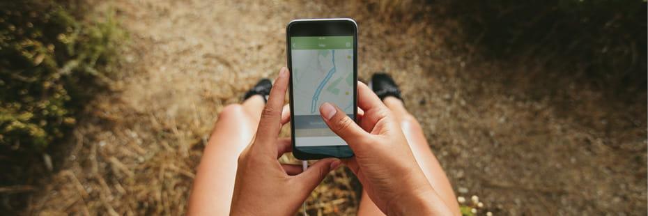 trail-runner-checking-fitness-app-on-phone