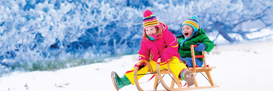 two-young-children-on-a-sled