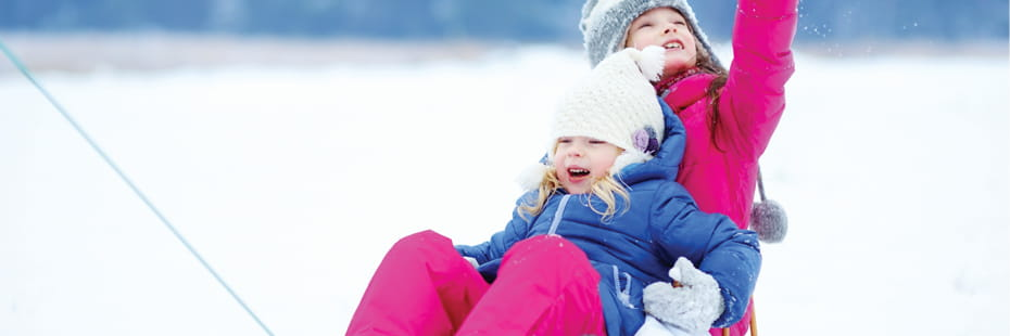 two-young-girls-sledding