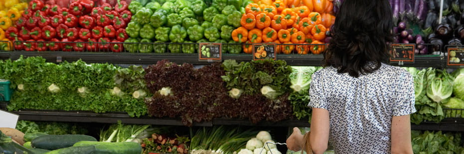 woman-in-fruits-and-vegetables-section-in-grocery-store