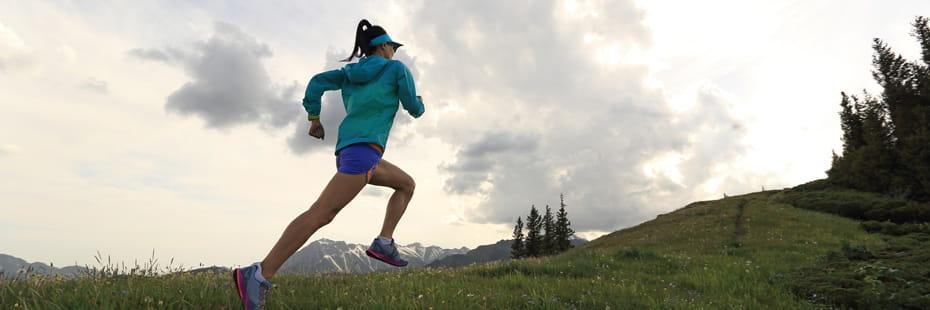 woman-running-up-a-mountain