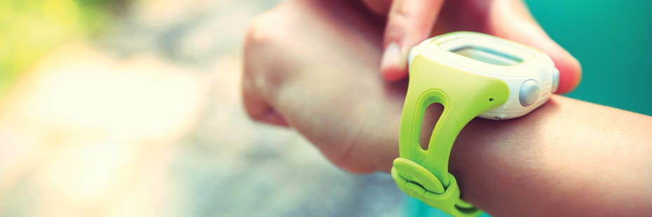 young-woman-runner-looking-at-gps-watch
