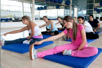 Group-of-gym-people-at-a-stretching-class