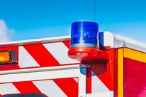 blue-flashing-light-on-a-red-ambulance