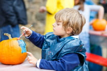 boy-painting-with-colors-on-a-pumpkin