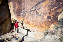 boy-points-to-petroglyphs-dinosauar-national-monument (2)