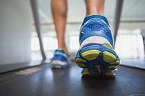 close-up-of-man-running-on-treadmill