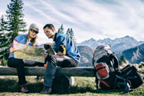 couple-viewing-map-to-prepare-for-mountain-hike