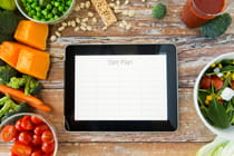 healthy-eating-app-on-tablet-sitting-with-healthy-foods