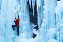 man-climbing-ice-wall-in-Ouray-Colorado-