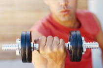 man-lifting-a-dumbell