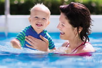 mother-and-happy-young-baby-swimming-in-pool