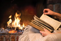 woman-reading-book-by-fireplace