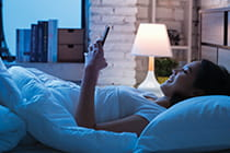 woman-using-cell-phone-at-night