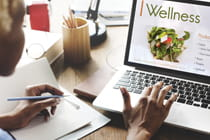 woman-viewing-online-wellness-program-on-laptop