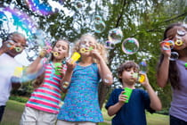 young-children-outside-blowing-bubbles