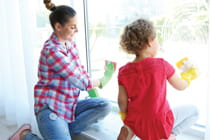 young-mother-and-daughter-cleaning-window