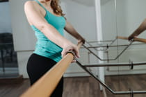 young-woman-standing-at-barre