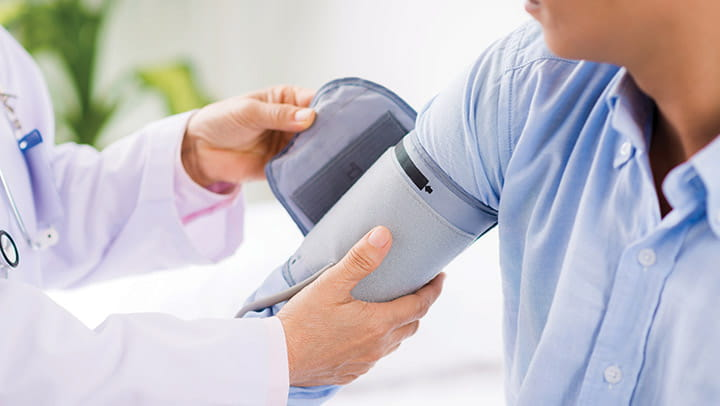 doctor-taking-patients-blood-pressure