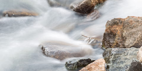 calm-river-flowing-over-rocks