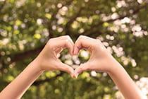 hands-making-shape-of-heart