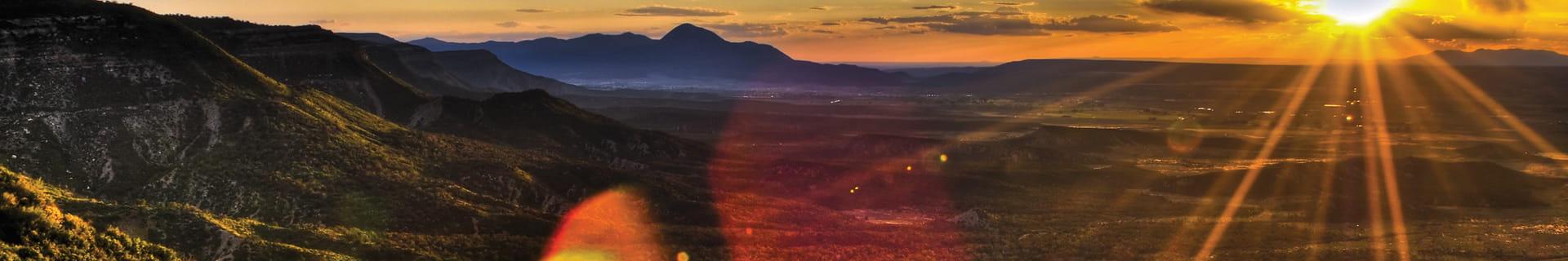 sunbeams-from-sunset-over-Colorado-landscape