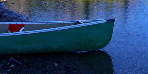 canoe-on-a-blue-calm-lake