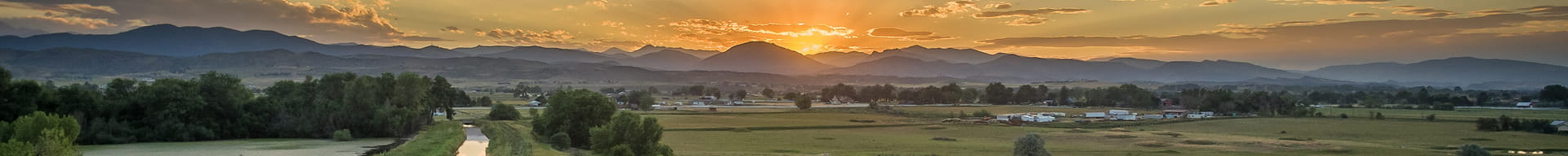 mountain-sunrise-over-rural-farm-town_desktop